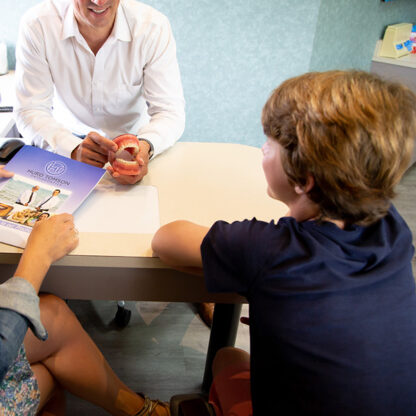 What causes orthodontic problems, and how will early prevention benefit my child?